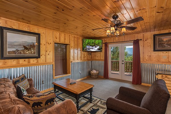 Deck access from the game room at Endless View, a 4-bedroom cabin rental located in Pigeon Forge