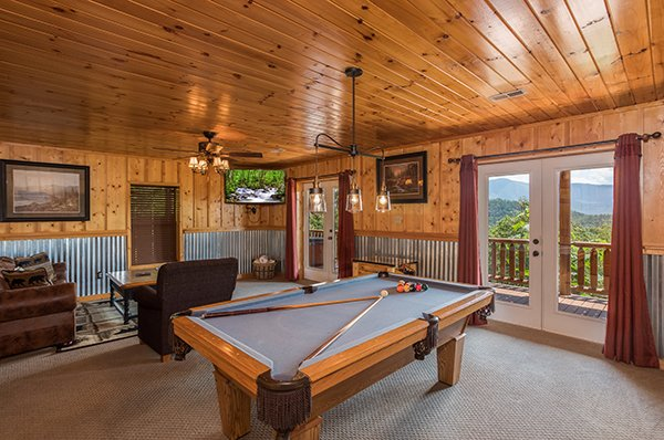 Game room with a pool table and tabletop multi game arcade system at Endless View, a 4-bedroom cabin rental located in Pigeon Forge