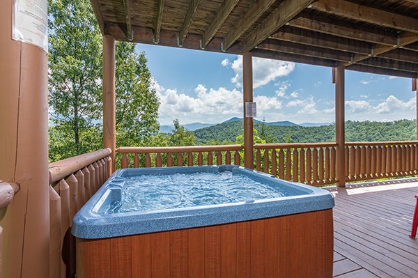 Mountain views can be seen from the hot tub at Endless View, a 4-bedroom cabin rental located in Pigeon Forge