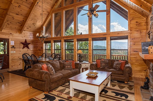 Lots of natural light in the floor-to-ceiling, room-length windows in the living room at Endless View, a 4-bedroom cabin rental located in Pigeon Forge