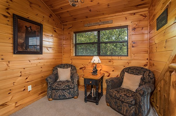 Reading nook with two chairs and a small table at Endless View, a 4-bedroom cabin rental located in Pigeon Forge