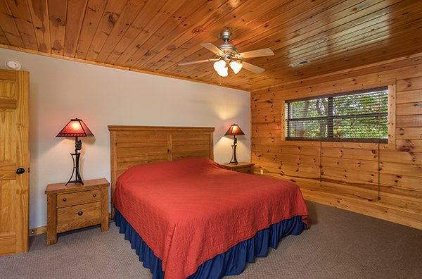 Bedroom with a queen bed and two end tables at Endless View, a 4-bedroom cabin rental located in Pigeon Forge