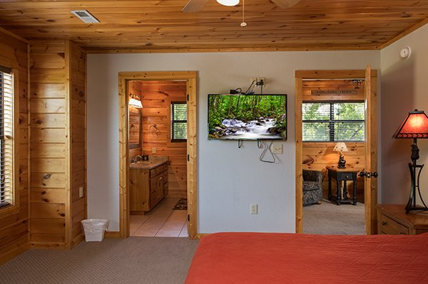 Television in the bedroom with an en suite bath at Endless View, a 4-bedroom cabin rental located in Pigeon Forge