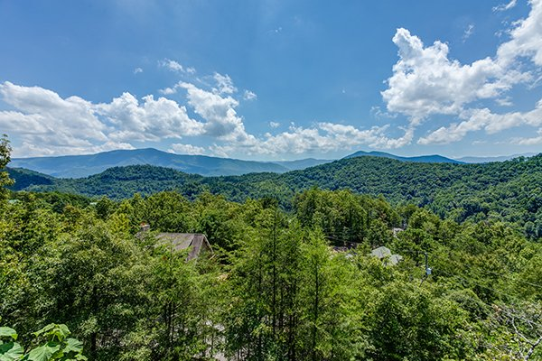 Looking down on the treetops and out at the mountains at Endless View, a 4-bedroom cabin rental located in Pigeon Forge