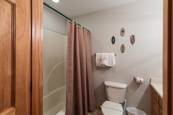 Bathroom with a tub and shower at Endless View, a 4-bedroom cabin rental located in Pigeon Forge