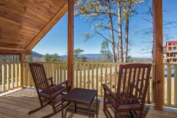Two rocking chairs overlooking the views at Gonzo's Outpost, a 3-bedroom cabin rental located in Pigeon Forge