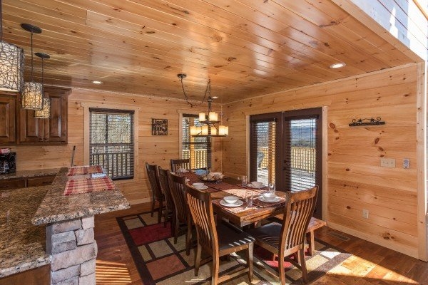Dining space for 10 at Gonzo's Outpost, a 3-bedroom cabin rental located in Pigeon Forge