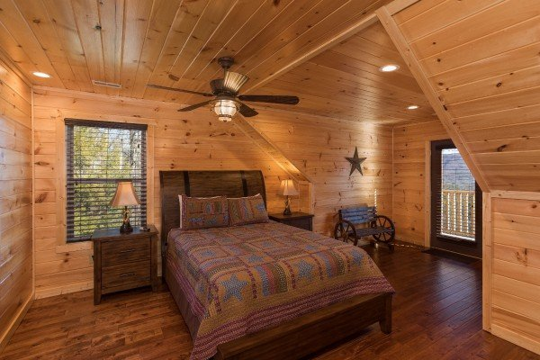 Bedroom in the loft with deck access at Gonzo's Outpost, a 3-bedroom cabin rental located in Pigeon Forge