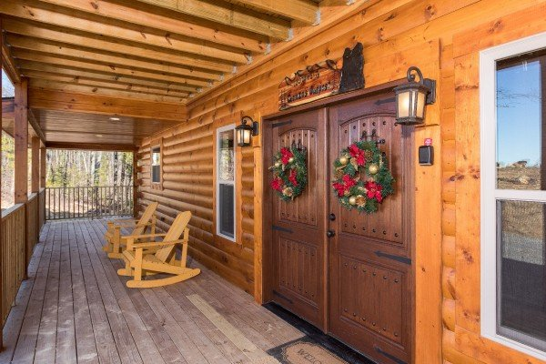 Front doors on a covered porch at Gonzo's Outpost, a 3-bedroom cabin rental located in Pigeon Forge