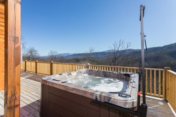 Hot tub on the deck at Gonzo's Outpost, a 3-bedroom cabin rental located in Pigeon Forge