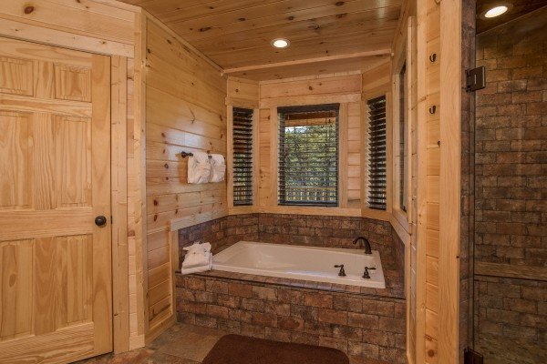 Jacuzzi off the main floor king bedroom at Gonzo's Outpost, a 3-bedroom cabin rental located in Pigeon Forge