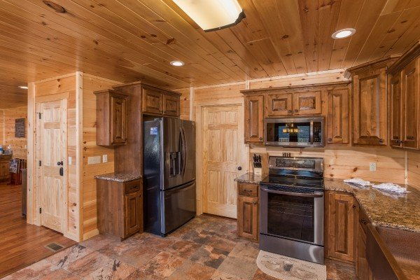 Kitchen with stainless appliances at Gonzo's Outpost, a 3-bedroom cabin rental located in Pigeon Forge
