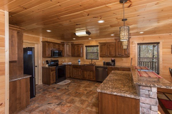 Large custom kitchen with stainless appliances at Gonzo's Outpost, a 3-bedroom cabin rental located in Pigeon Forge