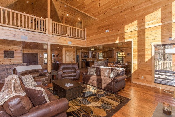Living room with two sofa beds and two chairs at Gonzo's Outpost, a 3-bedroom cabin rental located in Pigeon Forge