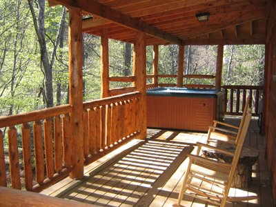Rocking chairs on covered deck at at Fishing Bears, a 1-bedroom cabin rental located in Gatlinburg