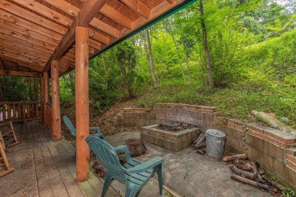 Large fire pit accessed from the lower level deck at Fishing Bears, a 1-bedroom cabin rental located in Gatlinburg