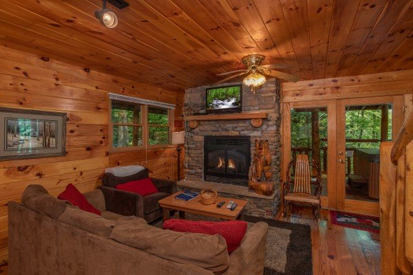 Living room with a fireplace and TV at Fishing Bears, a 1-bedroom cabin rental located in Gatlinburg