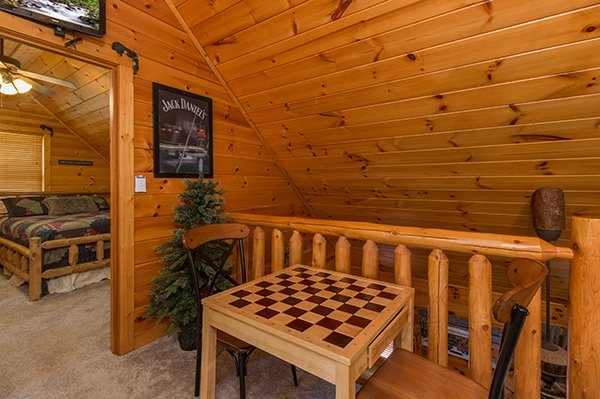 Checker game on the landing on the second floor at Gentleman Jack's, a 3-bedroom cabin rental located in Gatlinburg