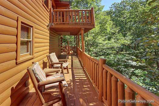Cushioned chairs on the deck at Gentleman Jack's, a 3-bedroom cabin rental located in Gatlinburg