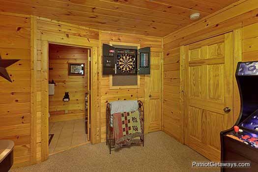 dart board in the game room at gentleman jack's a 3 bedroom cabin rental located in gatlinburg