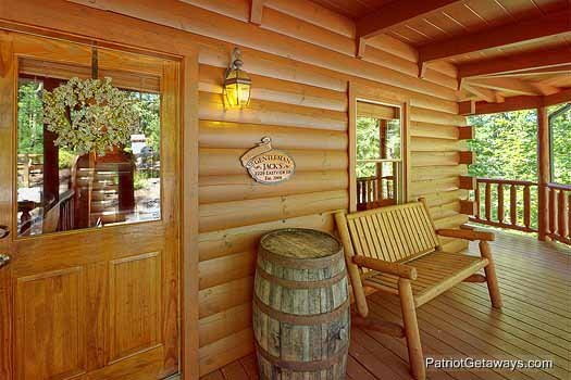 front door under the covered porch at gentleman jack's a 3 bedroom cabin rental located in gatlinburg