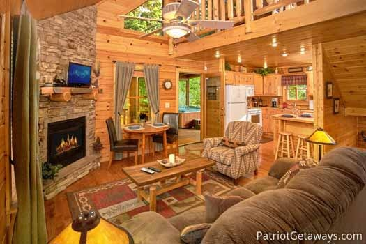 Living room with stone fireplace at Gentleman Jack's, a 3-bedroom cabin rental located in Gatlinburg