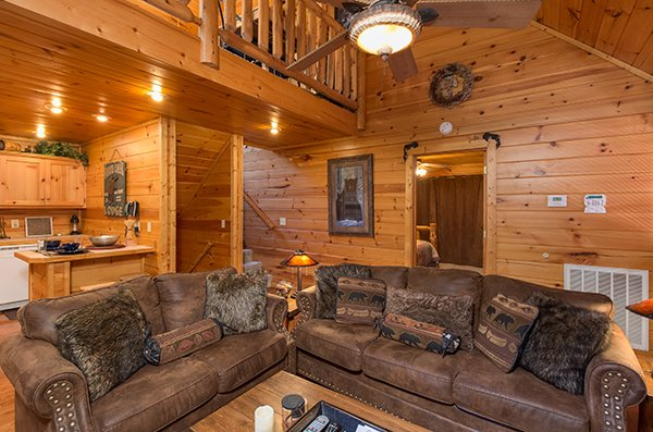 Living room with a sofa and loveseat at Gentleman Jack's, a 3-bedroom cabin rental located in Gatlinburg