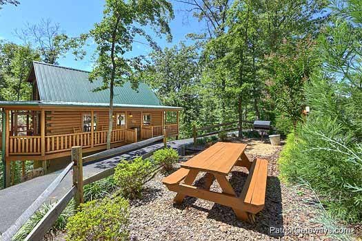 Picnic table in the grill area at Gentleman Jack's, a 3-bedroom cabin rental located in Gatlinburg