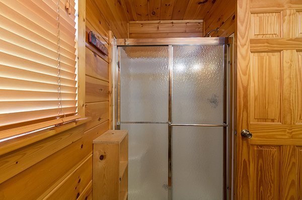 Shower in the upstairs bath at Gentleman Jack's, a 3-bedroom cabin rental located in Gatlinburg