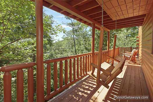 Swing on the back deck at Gentleman Jack's, a 3-bedroom cabin rental located in Gatlinburg