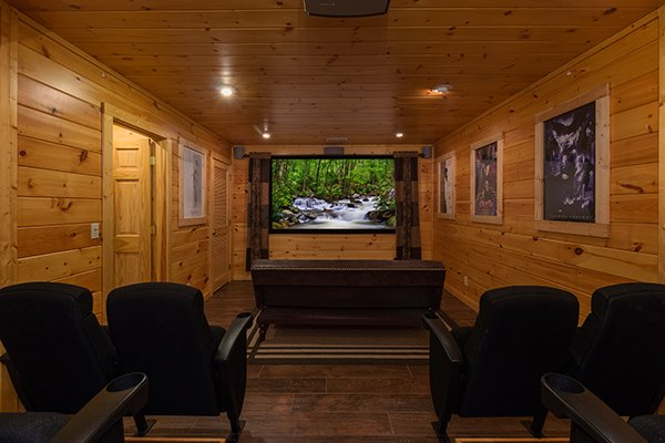 Theater room with a large screen and theater seats at Gentleman Jack's, a 3-bedroom cabin rental located in Gatlinburg