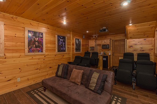 Couch and movie theater seats in the theater room at Gentleman Jack's, a 3-bedroom cabin rental located in Gatlinburg