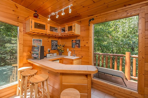 Wet bar in the game room space at Gentleman Jack's, a 3-bedroom cabin rental located in Gatlinburg