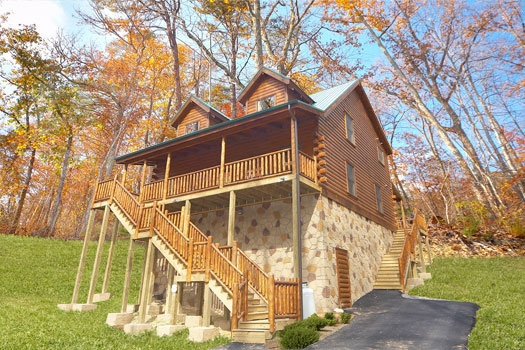 front view of steps up to main floor of a log cabin named big bear falls a 2 bedroom cabin rental located in gatlinburg
