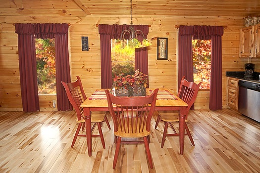 dining area with table for six people at big bear falls a 2 bedroom cabin rental located in gatlinburg