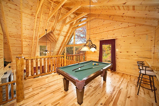 Green felted pool table in the lofted game room at Big Bear Falls, a 2-bedroom cabin rental located in Gatlinburg
