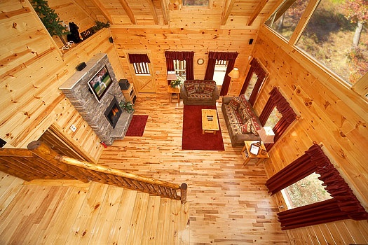 looking down into the living room from the lofted game room at big bear falls a 2 bedroom cabin rental located in gatlinburg