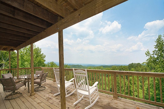 Views of the Smoky Mountains as seen from the deck at Astonishing Views, a 2-bedroom cabin rental located in Gatlinburg