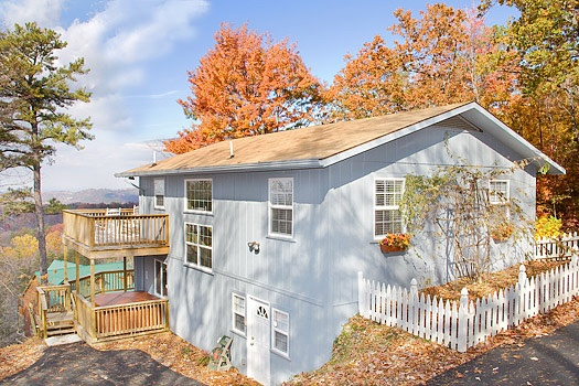 light blue painted exterior of astonishing views a 2 bedroom cabin rental located in gatlinburg