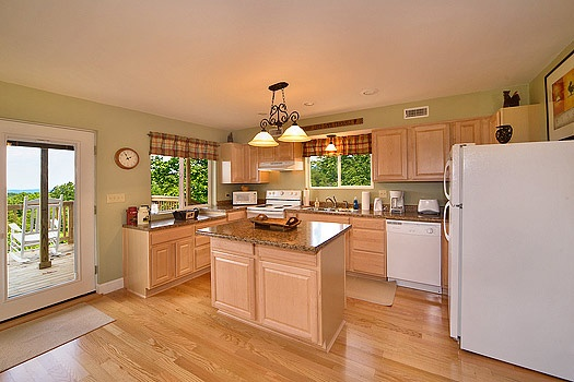 Kitchen with white appliances and an island at Astonishing Views, a 2-bedroom cabin rental located in Gatlinburg