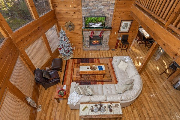 Looking down at the living room at King of the Mountain, a 3 bedroom cabin rental located in Pigeon Forge