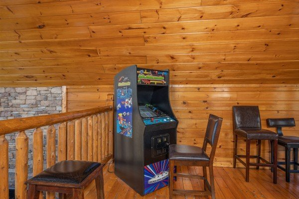 Arcade game at King of the Mountain, a 3 bedroom cabin rental located in Pigeon Forge