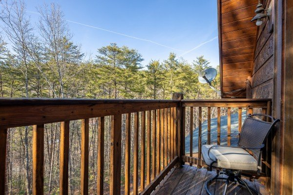 Deck chair at King of the Mountain, a 3 bedroom cabin rental located in Pigeon Forge