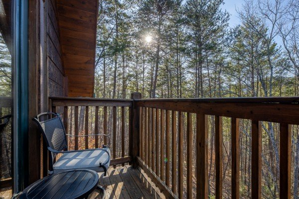 Forest views from the deck at King of the Mountain, a 3 bedroom cabin rental located in Pigeon Forge