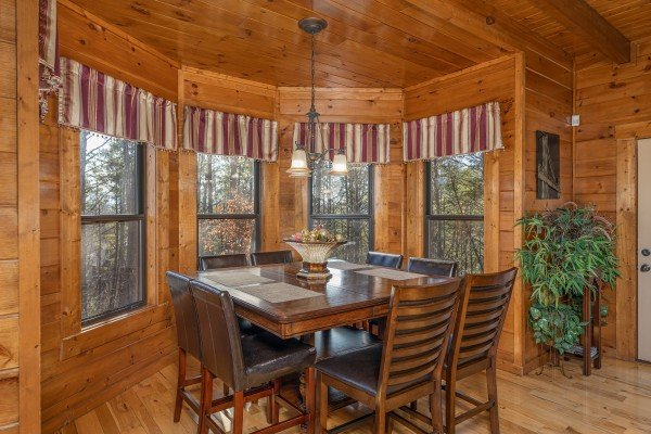 Dining table for 8 at King of the Mountain, a 3 bedroom cabin rental located in Pigeon Forge