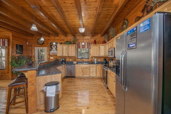 Kitchen with island breakfast bar and stainless appliances at King of the Mountain, a 3 bedroom cabin rental located in Pigeon Forge