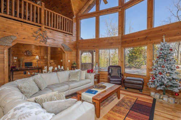 Living room with large sectional sofa at King of the Mountain, a 3 bedroom cabin rental located in Pigeon Forge