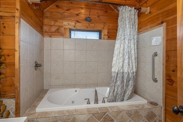 Bathroom with a jacuzzi and shower at King of the Mountain, a 3 bedroom cabin rental located in Pigeon Forge