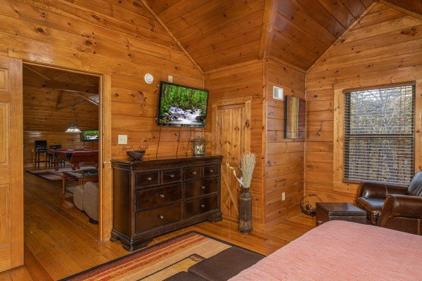 Dresser and TV in a bedroom at King of the Mountain, a 3 bedroom cabin rental located in Pigeon Forge