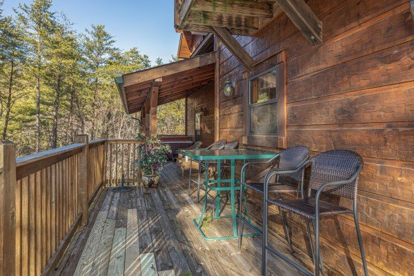Dining space on the lower deck at King of the Mountain, a 3 bedroom cabin rental located in Pigeon Forge